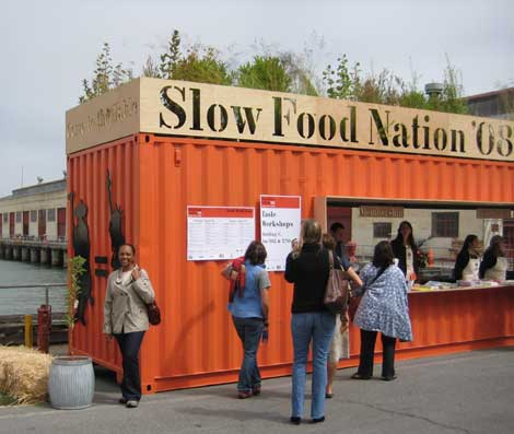 Tesia standing in from of the Slow Food Nation 08 Taste Pavillion Entrance in San Francisco
