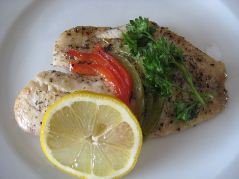 Tilapia en Papillote with bell peppers, parsley and lemon