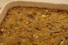 Baked apple-pecan cornbread dressing in a stoneware baking dish