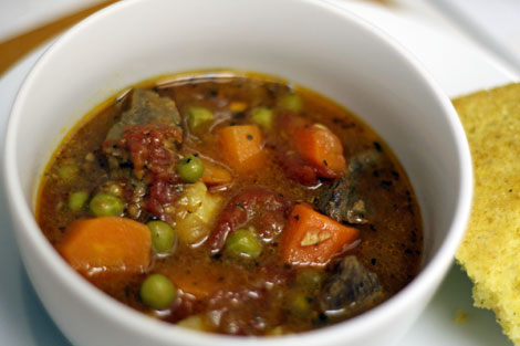Beef Stew with carrots, peas, potatoes, tomatoes and herbs