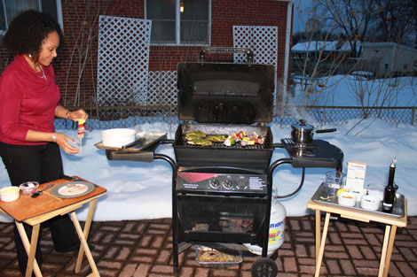 Tesia grilling outside with snow in the background for video clip to submit to Grill It With Bobby Flay -